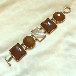 Bracelet with 5 brown stones and gold hardware
